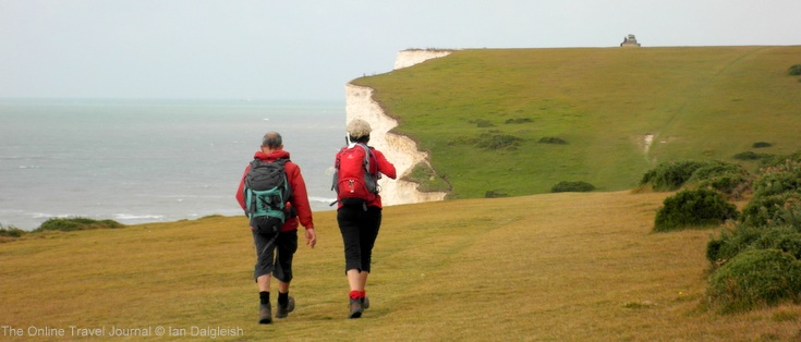Walkers striding out towards Flagstaff Hill, Seven Sisters, Sussex