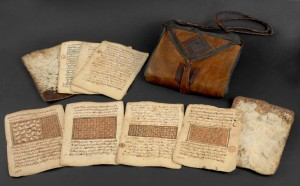 Saddlebag Qur'an from the late 18th or early 19th century on display in West Africa exhibition 2015. Photograph courtesy of the British Library